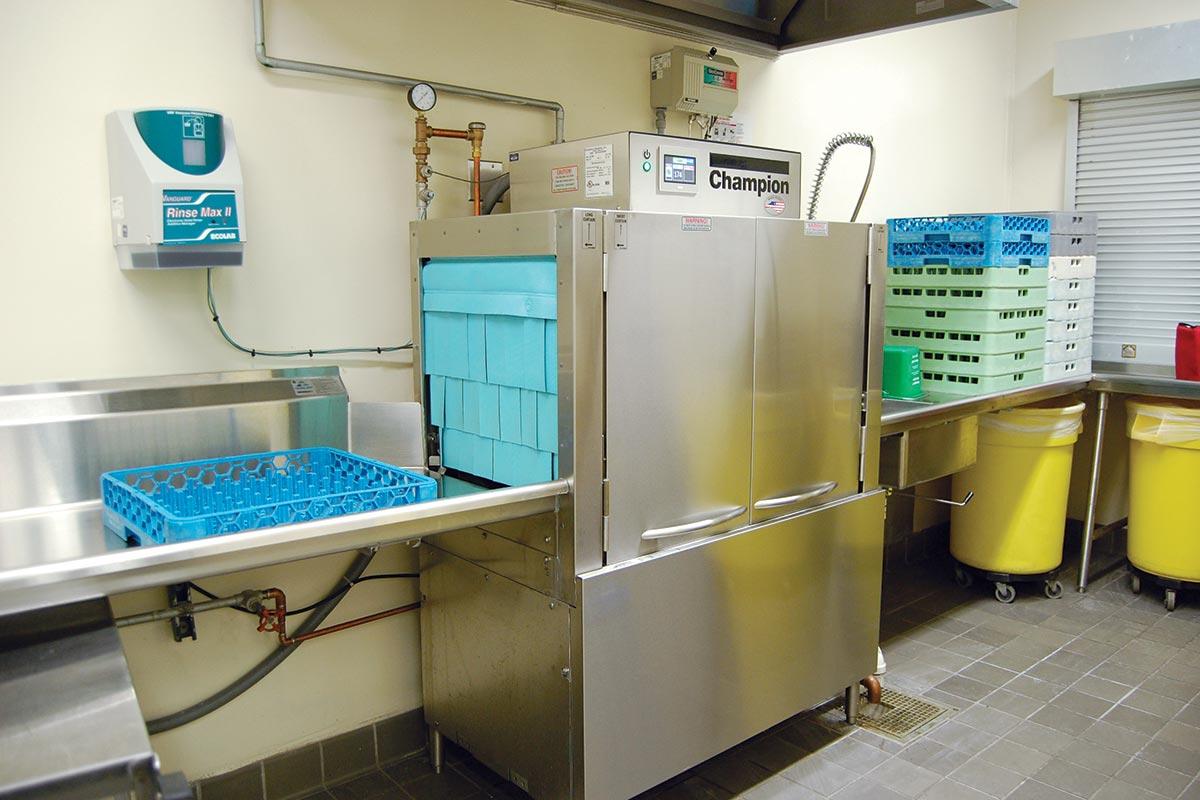 Rack conveyor warewasher with obstruction sensing technology