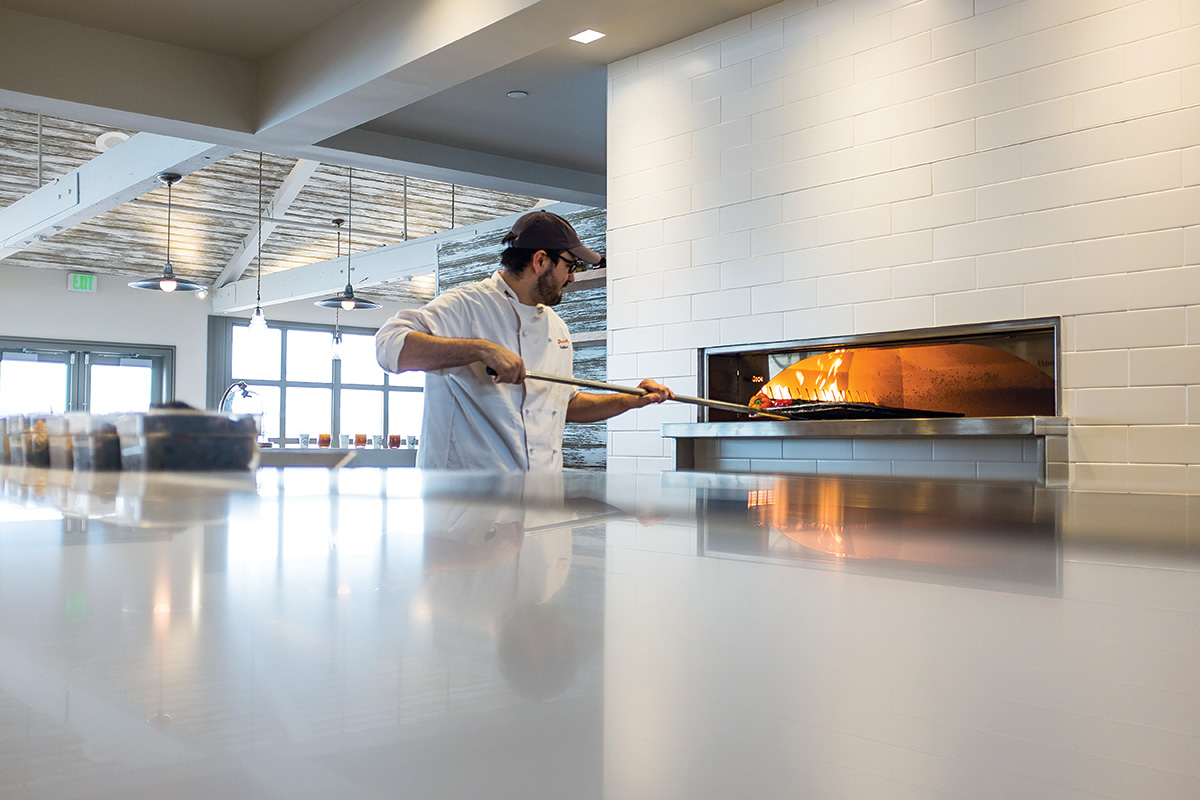 Student Using Hearth Oven at Institute of Culinary Education
