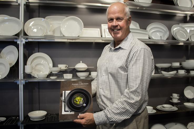 man holding china plate