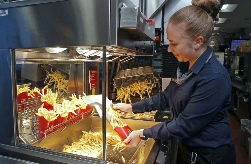 A McDonald's employee cooks French fries using advanced kitchen equipment at a restaurant outside Chicago, IL. The company will begin a global test of several kitchen innovations this year focused on making the jobs of employees easier. Handout photo/McDonald's Corporation