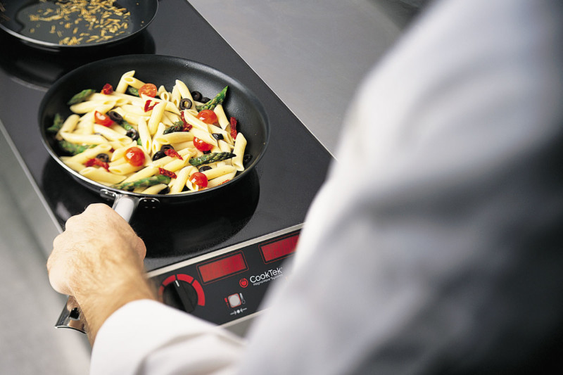 Makers have created durable induction units that stand up to the back-of-house. These units generate 2500W or more per hob and can withstand the heat and grease of a production kitchen. Courtesy of CookTek.