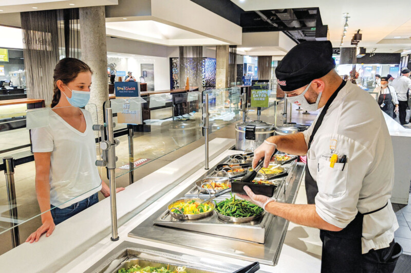 With self-service shelved for now, universities are offering staff-served dishes or prepackaged meals for carryout and delivery to limit dining room capacity. Photo courtesy of University of Massachusetts Amherst.