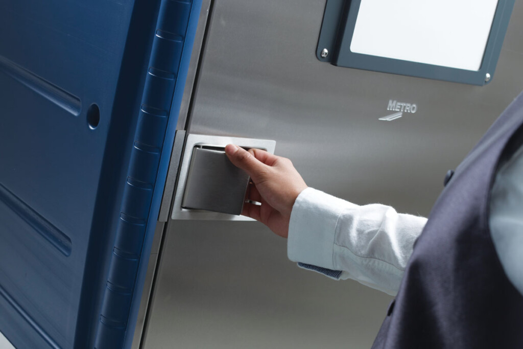 Practically everything about a mobile refrigerator's construction enables it to withstand transport. Here, a paddle latch that sits flush with the door won't get caught on wall corners or door frames. Courtesy of Metro.