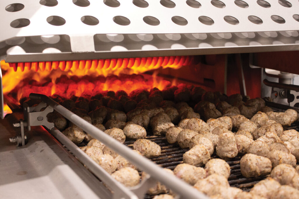 A flame grill sears grill marks onto meatballs at Kwik Trip