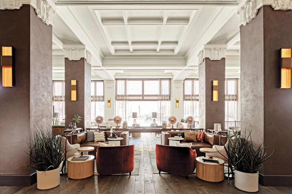 The lobby of the Surety Hotel reflects the building's 100-year-plus history with handapplied artisan plaster, coffered ceilings and transom windows. Informal elements such as wood, copper, leather and sturdy textiles balance the formal shell.